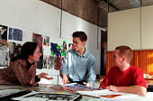 Graphic Design undergraduates involved in informal discussion over work - Roy Peters - 1990s,1997,art,arts,degree,Design,EDU education,Higher Education,mixed,painting,people,STUDENT,students,work