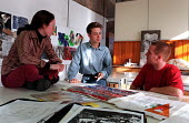 Graphic Design students involved in informal discussion over work - Roy Peters - 12-11-1997