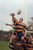 University rugby match. - Roy Peters - ,1990s,1997,a,ball,balls,catch,catching,COMPETITATIVE,competition,Edu Education,Higher Education,jump,jumping,male,man,men,people,person,persons,rugby,shirt,shirts,SPO sport,STUDENT,STUDENTS,support,u