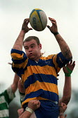 University rugby match. - Roy Peters - 1990s,1997,a,ball,balls,catch,catching,COMPETITATIVE,competition,Edu Education,Higher Education,jump,jumping,male,man,men,people,person,persons,rugby,shirt,shirts,SPO sport,STUDENT,STUDENTS,support,un