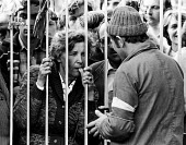 Families talk to striking Solidarnosc workers locked inside the Vladimir Lenin Shipyard, Gdansk, Poland, summer, 1980 - 2May Arkiv - 1980,1980s,activist,activists,adult,adults,against,CAMPAIGN,campaigner,campaigners,CAMPAIGNING,CAMPAIGNS,capitalism,capitalist,communicating,communication,conversation,conversations,couple,COUPLES,DEM