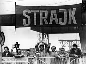 Striking dockers in support of Solidarnosc on the picket line at the harbour in Swinoujscie, on the Baltic coast, Poland, summer 1980 - 2May Arkiv - 1980,1980s,activist,activists,against,banner banners,CAMPAIGN,campaigner,campaigners,CAMPAIGNING,CAMPAIGNS,capitalism,capitalist,coast,coastal,coasts,DEMONSTRATING,Demonstration,DEMONSTRATIONS,DISPUTE