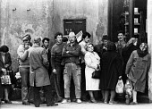 Queues in the street outside a food shop, Krakow, Poland, spring 1981 - 2May Arkiv - 1980s,1981,bought,buy,buyer,buyers,buying,commodities,commodity,consumer,consumers,customer,customers,demand,EBF Economy,food,FOODS,goods,in line,Krakow,line,man men,outlet,outlets,outside,people,Pola