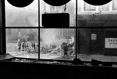Streets of Notting Hill viewed from the inside of a shop damaged in the Notting Hill race riots, London 1958 - Alan Vines - 24-09-1958