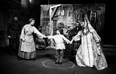 The Caucasian Chalk Circle by Berolt Brecht staged at the Aldwych Theatre in London in the summer of 1962 and starring Patsy Byrne, centre left, & Hugh Griffith, seated. - Alex Low - 10-06-1962