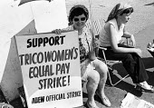 Women workers shelter from the sun on the picket line at TRICO, on strike for Equal Pay in 1976 - Angela Phillips - 1970s,1976,AUEW,campaign,campaigning,CAMPAIGNS,discrimination,DISPUTE,DISPUTES,EARNINGS,Equal Pay,equal rights,equality,fair pay,female,FEMININITY,feminism,feminist,feminists,Income,INCOMES,INDUSTRIAL