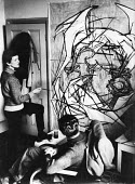 Artist and sculptor, Elisabeth Frink studying one of her paintings in Chelsea in 1953. - Alan Vines - 1950s,1953,abstract,ACE,art,artist,artists,arts,artwork,artworks,cities,city,communicating,communication,conversation,conversations,culture,dialogue,discourse,discuss,discusses,discussing,discussion,d