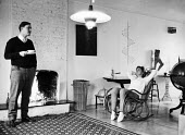 Couple in fashionable Chelsea apartment in 1953. - Alan Vines - 1950s,1953,abstract,ACE,adult,adults,AFFLUENCE,AFFLUENT,airy,and,apartment,apartments,art,arts,Bourgeoisie,chair,cities,city,class,communicating,communication,conversation,conversations,couple,COUPLES