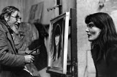 Water-colourist painter, Jospeh McCulloch, painting his model, Doreen, in his studio in Chelsea in 1953. - Alan Vines - 1950s,1953,ACE,art,artist,artists,arts,artwork,artworks,cities,city,culture,easel,female,figurative,Joe,Joseph,London,look,looking,male,man,McCulloch,men,model,models,observation,observing,paintbrush,