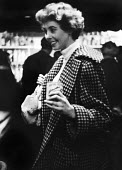 Pamela Crampton, a fashion model in Chelsea in 1953, who appears to be holding a chicken in her right hand - Alan Vines - 1950s,1953,alcohol,attractive,chicken,CHICKENS,cities,city,conversation,drink,drinker,drinkers,drinking,drinks,EMOTION,EMOTIONAL,EMOTIONS,fashion,fashionable,female,happiness,happy,LFL,LIFE,lifestyle,