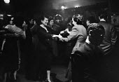 Lesbian women dancing, The Gateways Club, Chelsea, 1953, The Gates was one of the only places where lesbian women could meet openly and be together. Playing on the piano is Jack London, the first blac... - Alan Vines - 14-03-1953