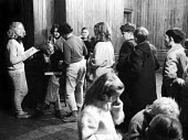 Summerhill School, Children queue for their pocket money distributed by AS Neill 1961, the 14 year old girl to his right is keeping a record, Leiston - Alan Vines - 1960s,1961,A.S.Neill,alternative,AS Neill,boy,BOYS,child,CHILDHOOD,children,co-educational,edu,educate,educating,education,educational,female,females,girl,GIRLS,juvenile,juveniles,kid,kids,knowledge,l