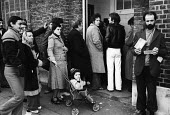 Unemployed people queueing up to claim their benefit at the Unemployment Exchange in Islington, London, 1977. - Bob Appleton - ,1970s,1977,adult,adults,asian,asians,BAME,BAMEs,benefit,benefit office,benefits,black,BME,bmes,cities,city,claim,cultural,diversity,dole,EARLY YEARS,employee,employees,Employment,ethnic,ethnicity,Exc