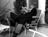 Author Andre Gide, winner of the 1947 Nobel Prize for Literature, reading a book written by Marcel Jouhandeau at Gides home in Antibes, France, 1949 - Dominique Darbois - 28-06-1949