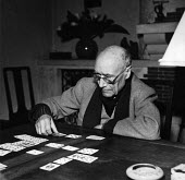 Author, Andre Gide, winner of the 1947 Nobel Prize for Literature, playing cards at his home in Antibes, France, 1949 - Dominique Darbois - 28-06-1949