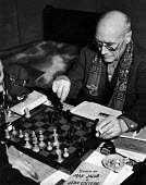 Author, Andre Gide, winner of the 1947 Nobel Prize for Literature, playing chess at his home in Antibes, France, 1949 - Dominique Darbois - 28-06-1949