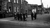 Salvation Army band playing in the street 1948, Peterlee, County Durham beside the local Empire picture house showing The Lost Angel. Peterlee was founded in 1948 following the New Towns Act two years... - Elizabeth Chat - 01-06-1948