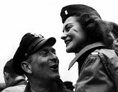 American GI stationed at Burtonwood USAF airbase near Warrington enjoys a moment at nearby Aintree racecourse with a young woman friend. The airbase was reopened in 1948 to support the Wests Cold War... - Elizabeth Chat - 1940s,1949,Air,Air force,aircraft,airforce,american,americans,armed forces,Cheshire,EMOTION,EMOTIONAL,EMOTIONS,female,Force,funny,GI,GI Bride,GI Brides,GIs,happiness,happy,Humor,HUMOROUS,HUMOUR,JOKE,J