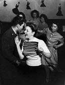 Local women dancing the jitterbug with off-duty American GIs from Burtonwood USAF airbase at the Broadway Club in Warrington. The airbase was reopened in 1948 to support the Wests Cold War effort thro... - Elizabeth Chat - 12-03-1949