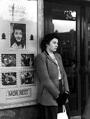 Lone woman waiting for the cinema to open on a Sunday afternoon in Warrington - Elizabeth Chat - 13-04-1949