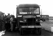 Bus at Burtonwood USAF airbase waiting to take American air crews to the repair hangars on the base. The airbase was reopened in 1948 to support the Wests Cold War effort through the maintenance and o... - Elizabeth Chat - 1940s,1949,Air,Air force,aircraft,aircrew,airforce,american,americans,armed forces,bus,bus service,buses,Cheshire,Cold War,Force,GI,GIs,Lancashire,male,man,men,military,people,person,persons,SERVICE,s