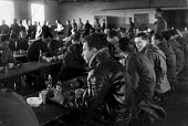 Lunchtime for American GIs in the canteen at the Burtonwood USAF airbase near Warrington. The airbase was reopened in 1948 to support the Wests Cold War effort through the maintenance and overhaul of... - Elizabeth Chat - 1940s,1949,Air,Air force,aircraft,aircrew,airforce,american,americans,armed forces,BREAK,canteen,CANTEENS,Cheshire,Cold War,DINNER,dinners,DINNERTIME,eat,eating,food,FOODS,Force,GI,GIs,Lancashire,lunc