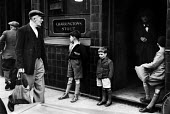 London street scene with men and boys outside a pub, early 1950's. .... - Elizabeth Chat - 11-07-1952
