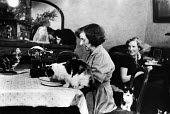 Two women use their home as a refuge for stray cats in London in 1952. .... - Elizabeth Chat - 1950s,1952,animal,animals,cat,cats,charitable,charity,cities,city,domestic,enjoy,enjoying,enjoyment,feline,FEMALE,giving,help,helping,HELPS,hobbies,hobby,hobbyist,home,housing,interest,Leisure,LFL,LIF