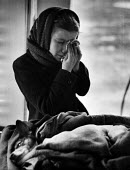 Young girl in tears having taken her ill dog in for treatment at a Mobile Dispensary For Sick Animals of The Poor, London in 1952. .... - Elizabeth Chat - ,1950s,1952,animal,animals,child,CHILDHOOD,children,cities,city,cry,crying,death,deaths,died,Dispensary,dog,DOGS,domestic,EQUALITY,excluded,exclusion,female,females,girl,girls,HARDSHIP,hea,health,hobb