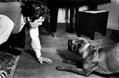 Boxer, Freddie Mills, at home with his pet bulldog in 1952. .... - Elizabeth Chat - ,1950s,1952,animal,animals,canine,cities,city,dog,dogs,domestic,having fun,hobbies,hobby,hobbyist,home,interest,Leisure,LFL,LIFE,London,male,man,men,owner,owners,OWNERSHIP,PEOPLE,person,persons,pet,pe