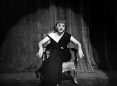The Lyric Revue, Lyric Theatre, London, 1951, based on music by Noel Coward, Donald Swann and others. Actor, Roberta Huby,on stage. - Elisabeth Chat and Inge Morath - 1950s,1951,ACE,acting,actor,actors,actress,actresses,cities,city,DANCE,DANCER,DANCERS,dancing,entertainment,FEMALE,London,melody,music,musical,people,person,persons,play,PLAYING,revue,singing,stage,th