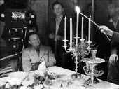 Film set of Anna Karenina, directed by Julien Duvivier, seated, London, 1947. - Felix H. Man - 19-07-1947