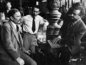 Film set of Anna Karenina, directed by Julien Duvivier, right, talking to actor, Ralph Pichardson on right, London, 1947. - Felix H. Man - 19-07-1947