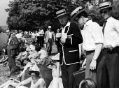 The idle rich at play at the Henley Regatta in an early 1950s summer. .... - Felix H. Man - 1950s,1951,AFFLUENCE,AFFLUENT,boater,boaters,Bourgeoisie,class,elite,elitism,England,EQUALITY,FEMALE,high,high income,income,INCOMES,INEQUALITY,leisure,LFL,LIFE,male,man,men,middle,PEOPLE,person,perso