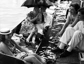 Punts. The idle rich at play at the Henley Regatta in an early 1950s summer. .... - Felix H. Man - 1950s,1951,adult,adults,AFFLUENCE,AFFLUENT,boat,boater,boaters,boating,boats,Bourgeoisie,class,couple,couples,elite,elitism,England,EQUALITY,FEMALE,high,high income,income,INCOMES,INEQUALITY,leisure,L