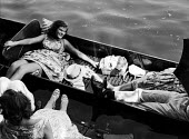 Punts. The idle rich at play at the Henley Regatta in an early 1950s summer. .... - Felix H. Man - 1950s,1951,AFFLUENCE,AFFLUENT,alcohol,binge,boat,boater,boaters,boating,boats,Bourgeoisie,class,drink,drinker,drinkers,drinking,drinks,drunk,drunken,drunkenness,elite,elitism,England,EQUALITY,female,h