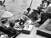 Punts. The idle rich at play at the Henley Regatta in an early 1950s summer. .... - Felix H. Man - 1950s,1951,AFFLUENCE,AFFLUENT,alcohol,boat,boating,boats,Bourgeoisie,class,drink,drinker,drinkers,drinking,drinks,elite,elitism,England,EQUALITY,EXERCISE,exercises,female,hat,hats,high,high income,inc