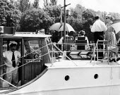 The idle rich at play aboard a small private yacht called Titmouse at the Henley Regatta in an early 1950s summer. .... - Felix H. Man - 1950s,1951,AFFLUENCE,AFFLUENT,boat,boats,Bourgeoisie,Captain,class,elite,elitism,England,EQUALITY,high,high income,income,INCOMES,INDEPENDENT,INEQUALITY,leisure,LFL,LIFE,lifestyle,male,man,men,middle,