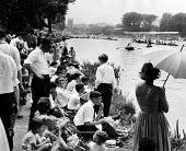 Watching the boat race. The idle rich at play at the Henley Regatta in an early 1950s summer. .... - Felix H. Man - 1950s,1951,AFFLUENCE,AFFLUENT,boat,boater,boaters,boats,Bourgeoisie,child,CHILDHOOD,children,class,crowd,elite,elitism,England,EQUALITY,FEMALE,high,high income,income,INCOMES,INEQUALITY,juvenile,juven