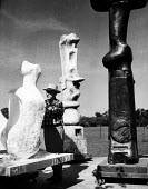 Sculptor, Henry Moore, working at his open air studio in Much Hadham, Hertfordshire in the early to mid 1950s. .... - Felix H. Man - 11-05-1953