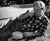 Sculptor, Henry Moore, relaxing at his open air studio in Much Hadham, Hertfordshire in the early to mid 1950s. .... - Felix H. Man - 11-05-1953