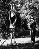 Sculptor, Henry Moore, at his open air studio in Much Hadham, Hertfordshire in the early to mid 1950s. .... - Felix H. Man - 11-05-1953