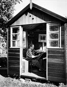 Sculptor, Henry Moore, drawing undisturbed in his small hut in his garden at his open air studio in Much Hadham, Hertfordshire in the early to mid 1950s. The hut was built on a turntable so that Moore... - Felix H. Man - 11-05-1953