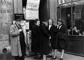 French citizens queuing to buy tickets for a special draw for the French National Lottery, Easter, 1949, France. .... - Ina Bandy - 13-04-1949