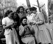 French women pooling their resources to buy tickets for a special draw for the French National Lottery, Easter, 1949, France. .... - Ina Bandy - 13-04-1949