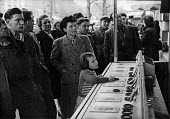 French citizens looking on as a special draw for the French National Lottery is made, Easter, 1949, France. .... - Ina Bandy - 13-04-1949