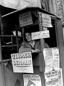 Woman selling lottery tickets from a booth for a special draw for the French National Lottery, Easter, 1949, France. - Ina Bandy - 12-04-1949