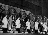 White-coated technicians stand alongside young French boys and girls as they prepare to manually draw balls from the machines behind them in a special draw for the French National Lottery, Easter, 194... - Ina Bandy - 13-04-1949