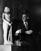 Artist, Maurice Utrillo, beside a stone sculpture of St. Joan of Arc, 1952, France. .... - Ina Bandy - 1950s,1952,ACE,art,artist,artists,arts,artwork,artworks,culture,eu,Europe,european,europeans,eurozone,france,french,male,man,Maurice,men,modern,modernism,modernist,modernists,painter,painters,people,p