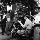 Film Director John Huston on the set of Moulin Rouge 1952 Paris, France. Jose Ferrer as painter Toulouse Lautrec (L) - Ina Bandy - 1950s,1952,ACE,ACE arts,acting,actor,actors,adult,adults,camera,cameraman,cameras,cinema,costume drama,culture,Directing,Director,director directors,DIRECTORS,drama,DRAMATIC,entertainment,eu,Europe,eu